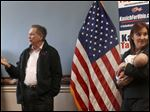 Mr. Kasich, center, and Lt. Gov. Mary Taylor address supporters on a stop at the Hancock County Republican headquarters in Findlay.