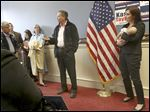 Republican Gov. John Kasich, center, and Lt. Gov. Mary Taylor, right, address supporters at the Hancock County Republican headquarters in Findlay. Lt. Gov. Taylor held Findlay Mayor Lydia Mihalik's 8-week-old daughter Delaney Jo Ann for the entire stop.