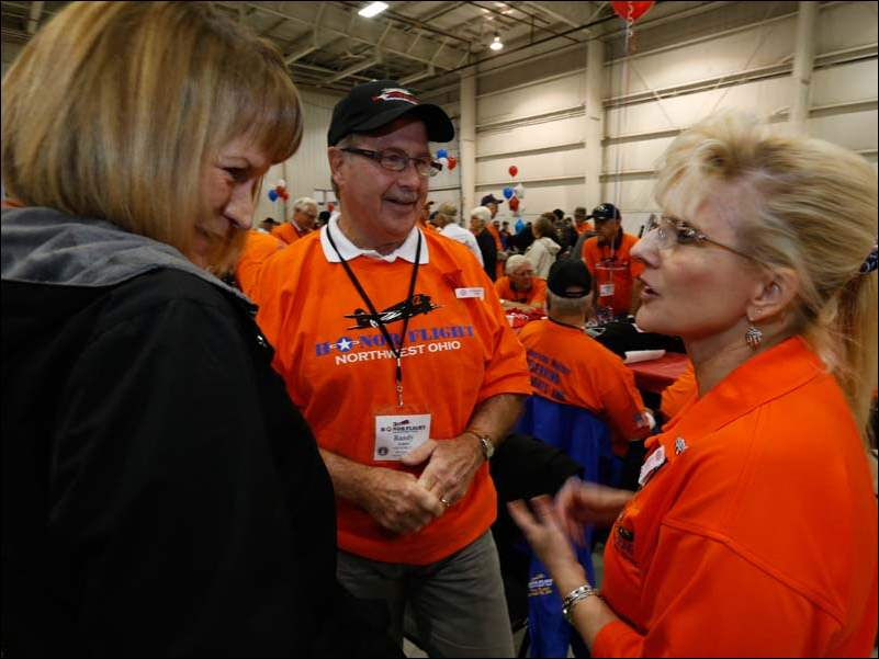Dolly Ames, left, her husband Randy Ames, both of Northwood, and Beth Emery, an Honor Flight board member, of Toledo. Randy Ames, who was in the U.S. Air Force 1968-72, went on a previous flight, and just came to support the others.