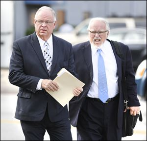 Bradford Huebner, left, arrives at federal court  for his sentencing with his attorney, Rick Kerger.