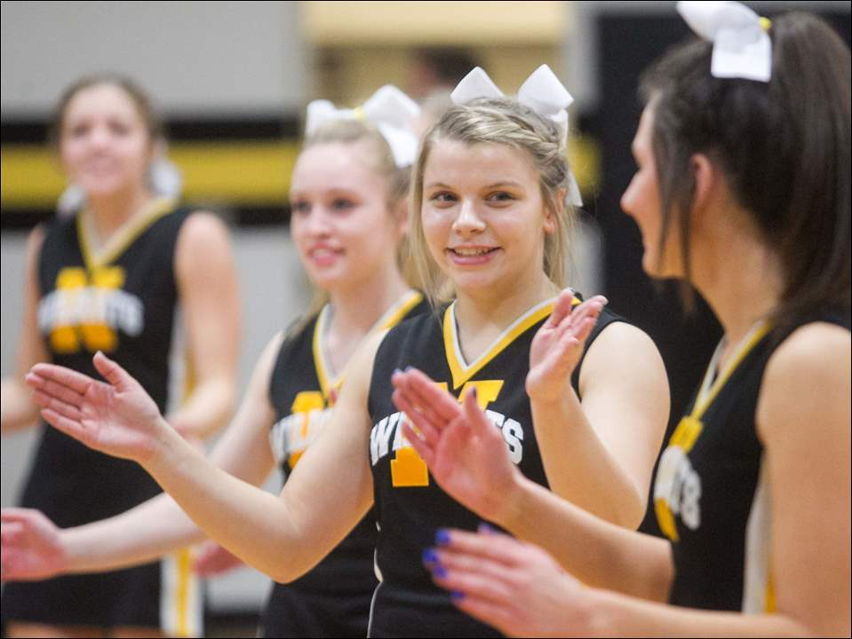 Cheerleaders, including senior Kara Zielinski, second from right, cheer during the prep rally.