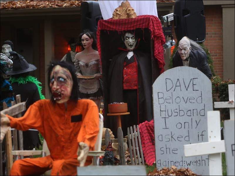 Costumed trick-or-treaters were invited to navigate the front yard graves for a piece of candy in front of the vampire, a disguised homeowner Dave Spiess.