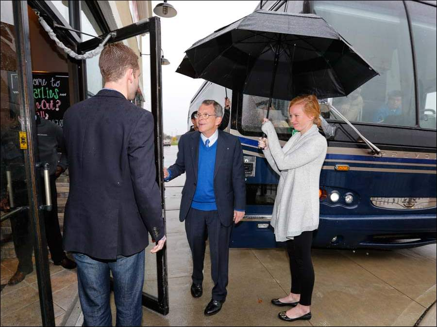 Ohio Attorney General Mike DeWine exits a bus and heads into Charlie's Restaurant.
