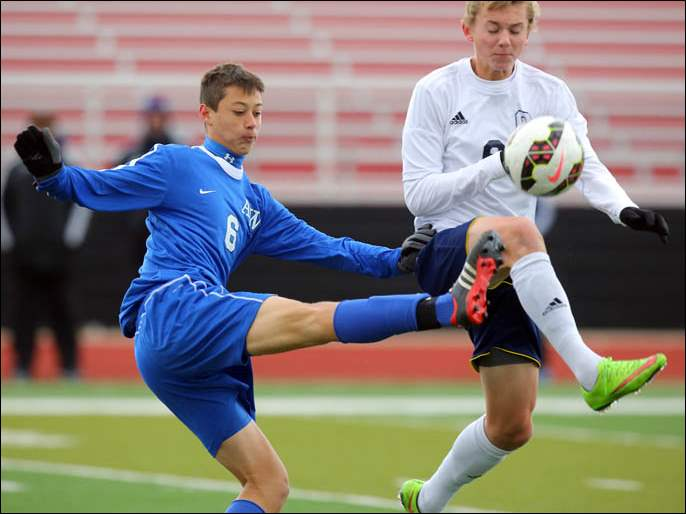 Anthony Wayne's Alec Marshall (6) kicks the ball against Copley's Joey Schulte.