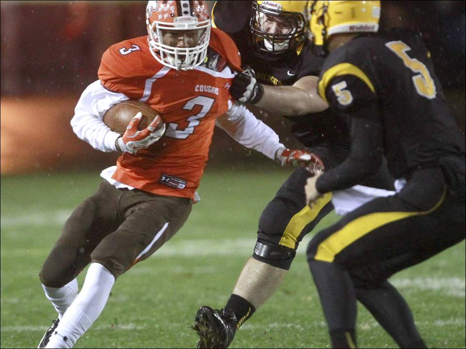 Southview's Tre Simms runs with the ball as Northview's Luke Fortner tries to hold him back.