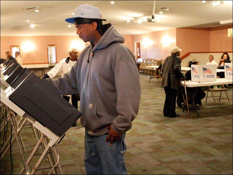 Qunicy Hogan casts his vote at the Warren AME Church in central Toledo.