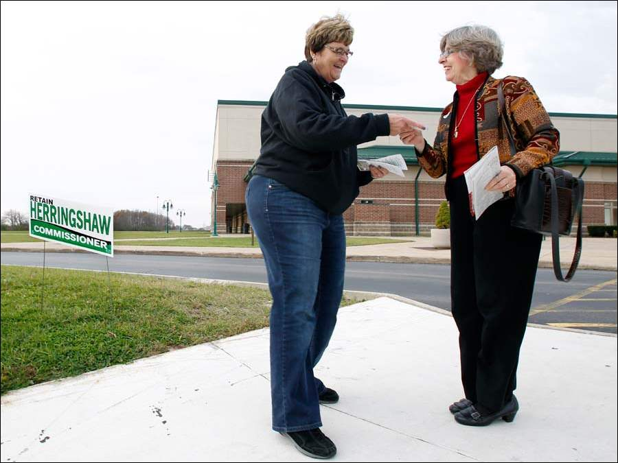Wood County Commissioner Doris Herringshaw, left, speaks to voter Janell Vickers, right, outside of poll location Perrysburg High School. Herringshaw is running for re-election.