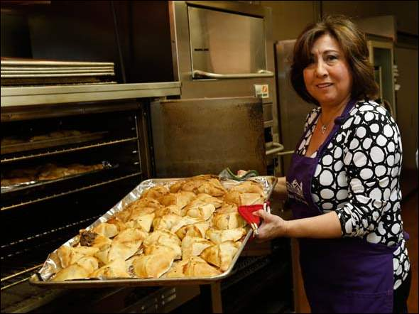 Amira Darah, president of the Ladies Society of St. Elias Orthodox Church, with home made meat pies.