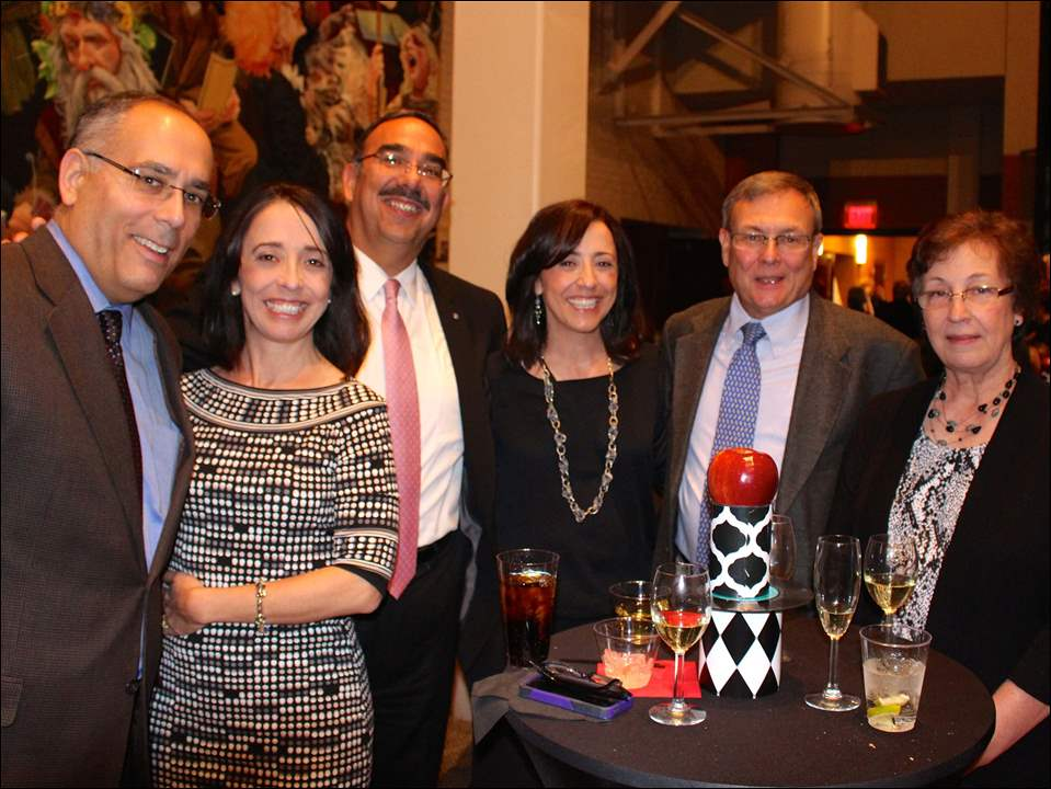 Enjoying the afterconcert soiree are, from left, Dr. Patrick Waters and his wife Linda, Mark and Lisa Urrutia, and Dennis and Judy Jenssen.