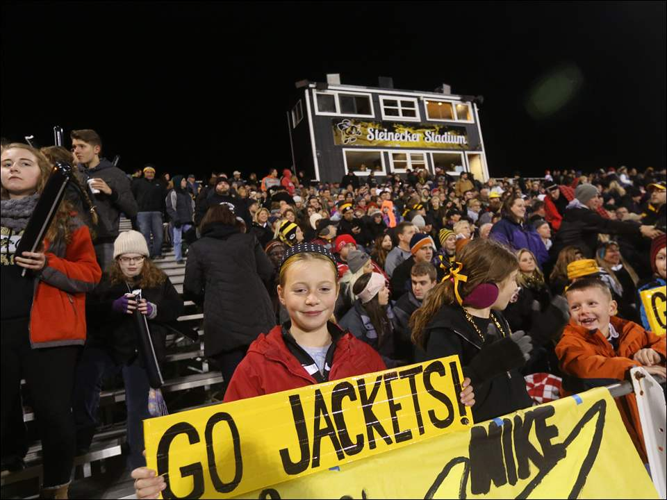 Perrysburg's fan Josie Hubbard, 10, sports a sign in support of her team.
