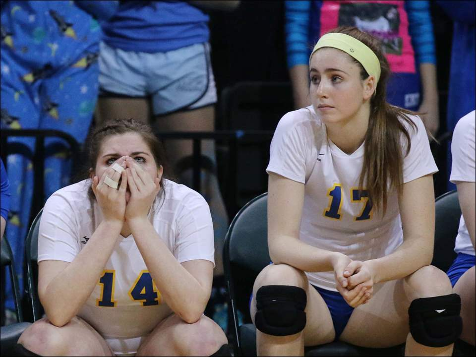 St. Ursula Academy players Mckenna Jordan (14) and Morgan Finn dejected after the game.