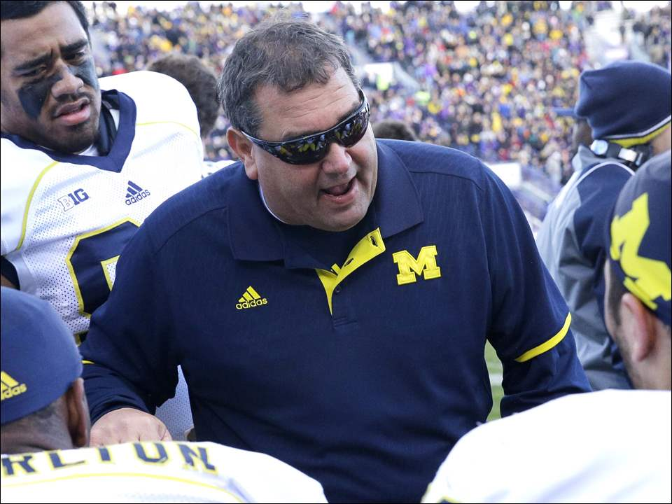 Michigan head coach Brady Hoke talks to his team during the first half.