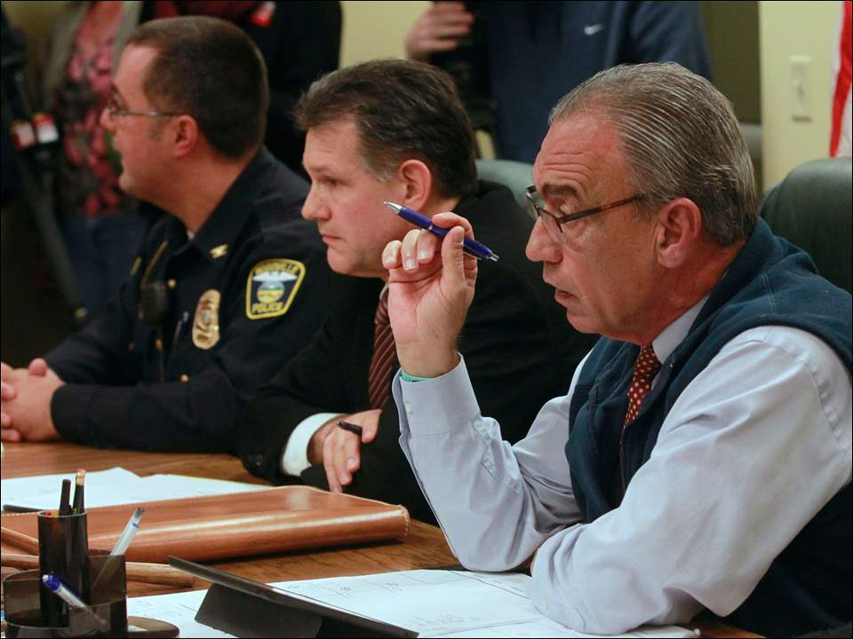 From left: Woodville police chief Roy Whitehead, prosecutor Robert Kuhlman and mayor Rich Harman attend a meeting in the council chambers of the Woodville Municipal building in Woodville, Ohio. Residents filled the chambers regarding a police officer's action when he shot Moses.
