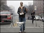 Brian Wilson launches a small drone equipped with a video camera to fly over the scene of an explosion that leveled two apartment buildings in the East Harlem neighborhood of New York in March.