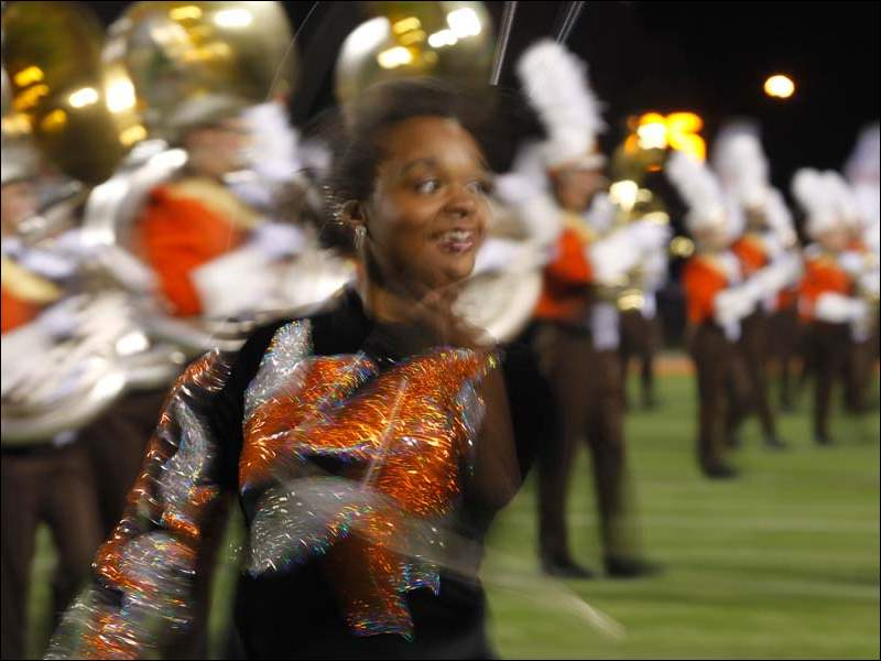 One of the Bowling Green State University Falcon Marching Band's twirlers performs during pregame at Doyt Perry Stadium.