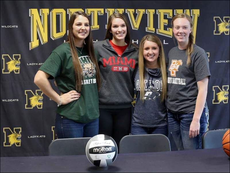 Northview students, from left, Kendall Jessing, 17, Kendall McCoy, 17, Abbey Pawlak, 17, and Maddie Cole signed national letters of intent to play college sports Wednesday at Northview High School.