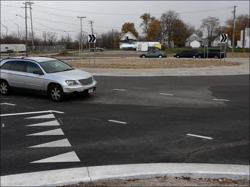 One of the two roundabouts connecting Cherry Street and Detroit Avenue is fully functioning while the Cherry Street and Manhattan Boulevard roundabout remains partially closed.