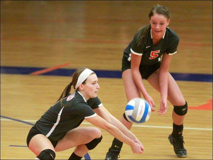 Bedford's Samantha Brown, left, passes the ball as teammate Nicole Rightnowar looks on.