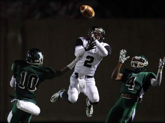 Perrysburg DB Seth Durham (2) breaks up a pass intended for Nordonia receivers Denzel Ward (4).