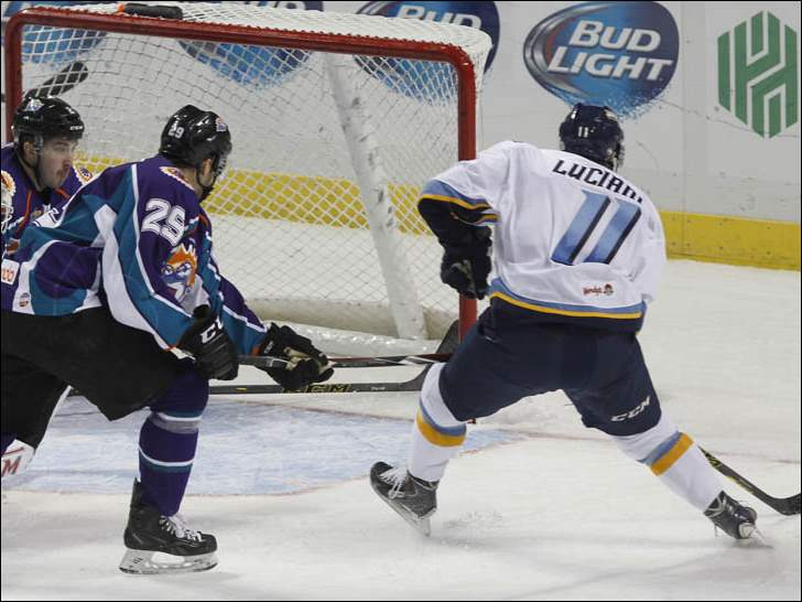 Toledo Walleye's Anthony Luciani, far right, scores against the Orlando Solar Bears