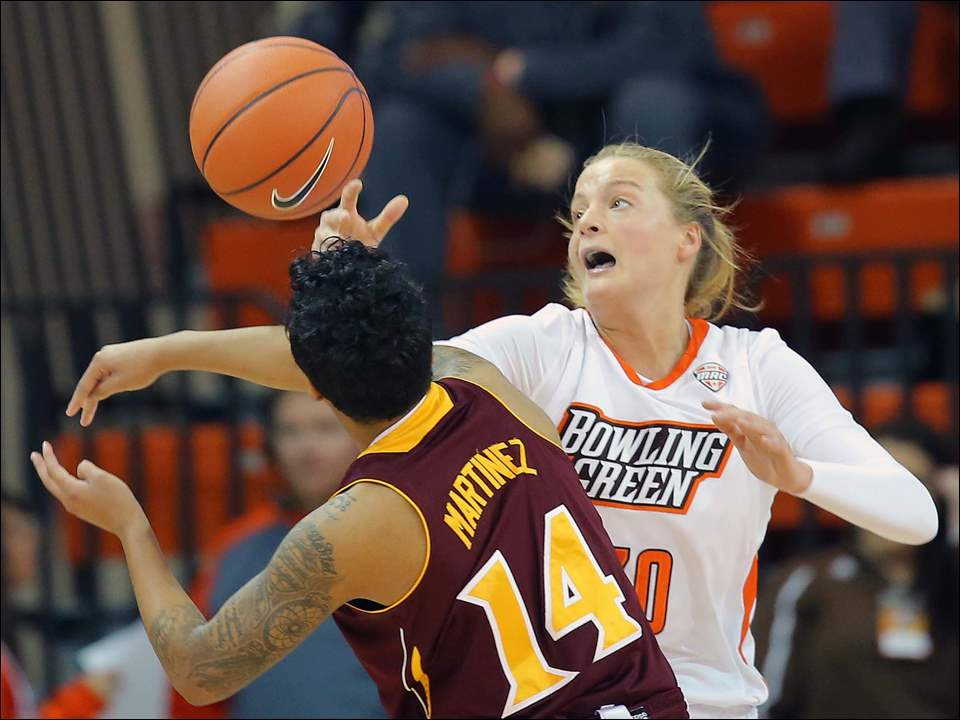Bowling Green State University guard Miriam Justinger (30) defends against Iona College Gaels guard Damika Martinez (14).