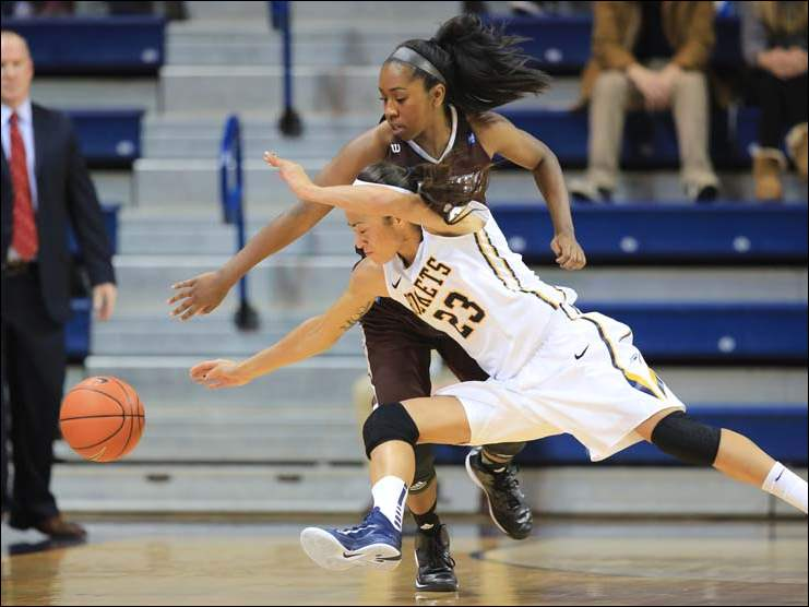 UT guard Inma Zanoguera (23) knocks the ball away from St. Bonaventure guard Imani Outlaw (22).