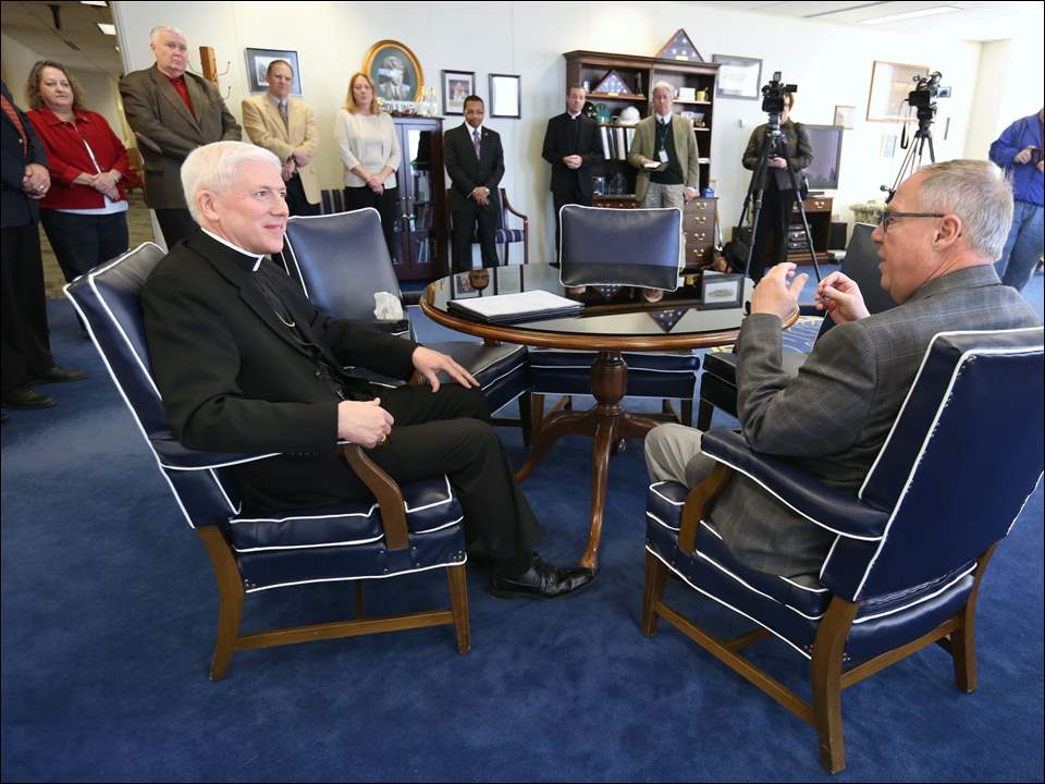 Bishop Daniel Thomas, left, and Toledo Mayor D. Michael Collins, meet Friday, November 21, 2014