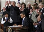 President Obama is applauded after signing the Affordable Care Act into law in March, 2010 at the White House in Washington.