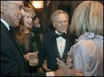 Dick Wilinski, left, and his wife, Shelley, right, greet Dick Cavett  and his wife, Martha Rogers, center left, during the cocktail hour of the President's Dinner at the Toledo Club.