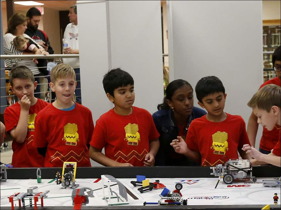 Students from the Block Heads team compete during the First Lego League Expo at Sylvania Southview High School in Sylvania, Ohio.