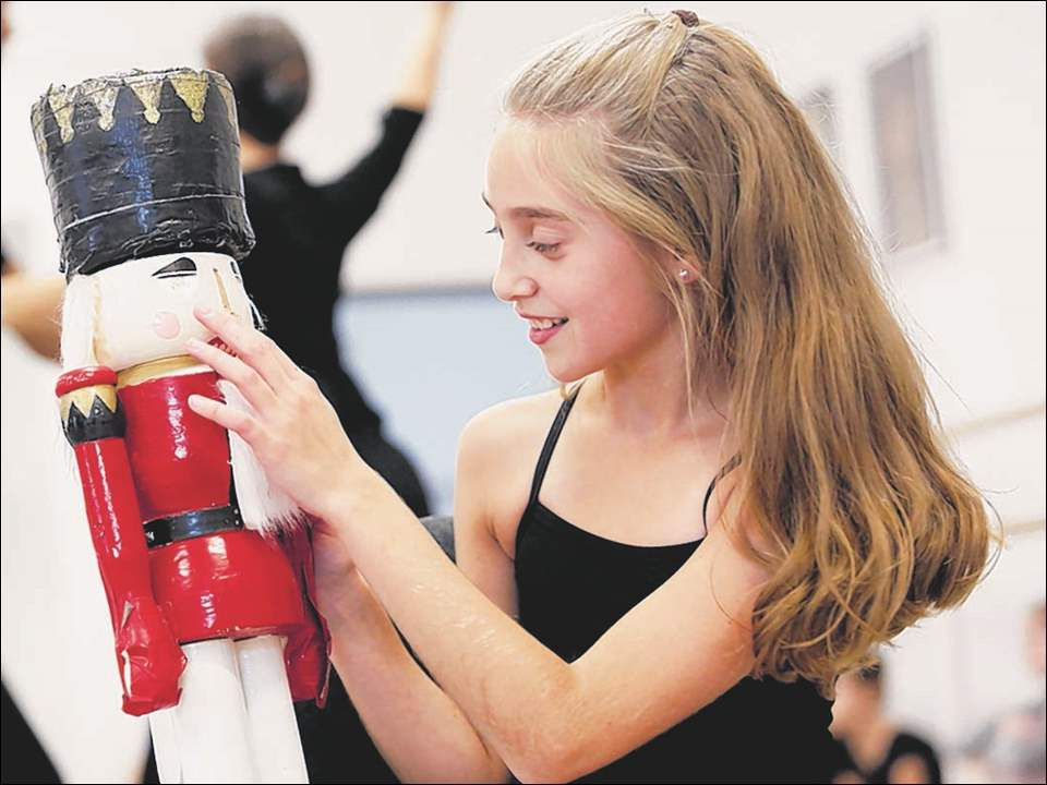 Emma Hennessey, 11, who plays Clara, performs during rehearsal.
