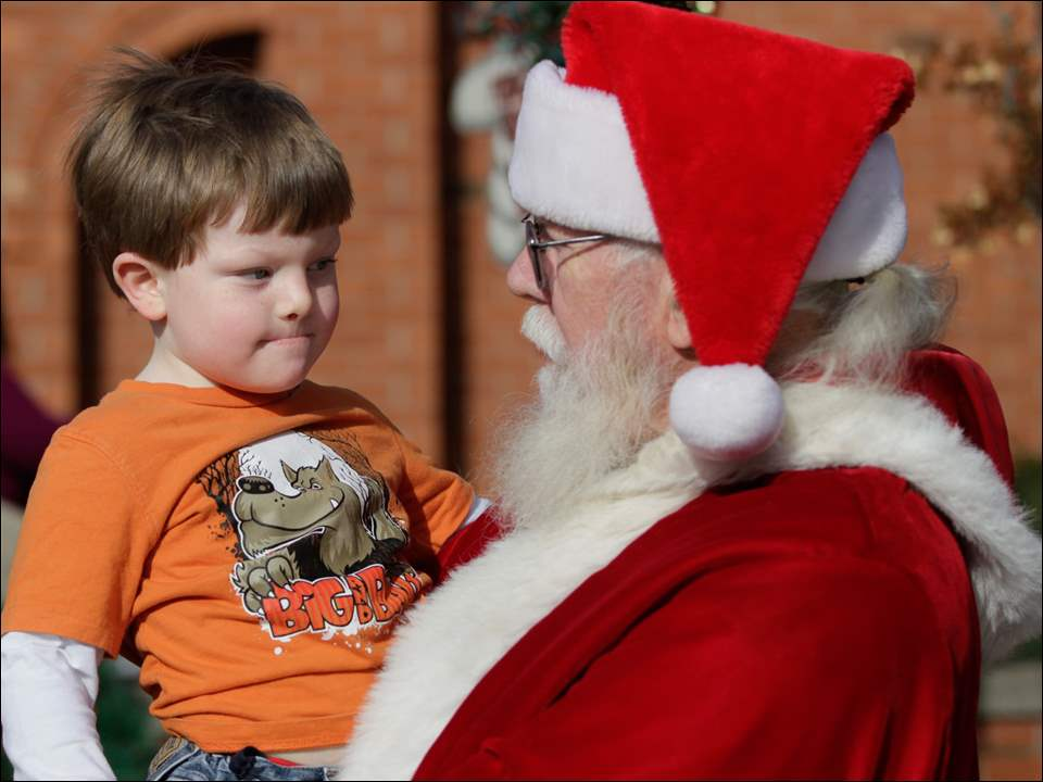Colton Laws, 4, of Toledo, and Santa Claus on Front Street in Grand Rapids.