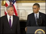 President Obama, standing with Defense Secretary Chuck Hagel, talks about Hagel's resignation during a news conference at White House today.