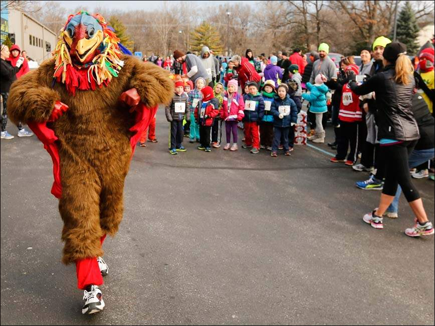 A turkey prepares to lead children in a race during the annual St. James Club Rick Gomez Memorial Smoke the Turkey 5K.