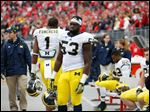 University of Michigan football player Mario Ojemudia (53) has signed with Baltimore.
