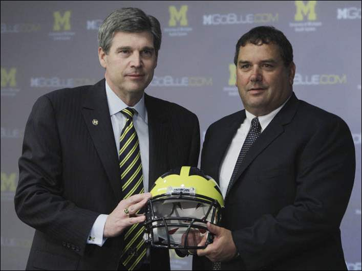 University of Michigan Athletic Director Dave Brandon, left, stands with new head football coach Brady Hoke at a news conference in Ann Arbor, Mich., Wednesday, Jan. 12, 2011.