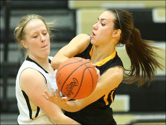 Northview guard Haley Archibeque (2) tries to get past  Perrysburg guard Kayla Piezer (30).
