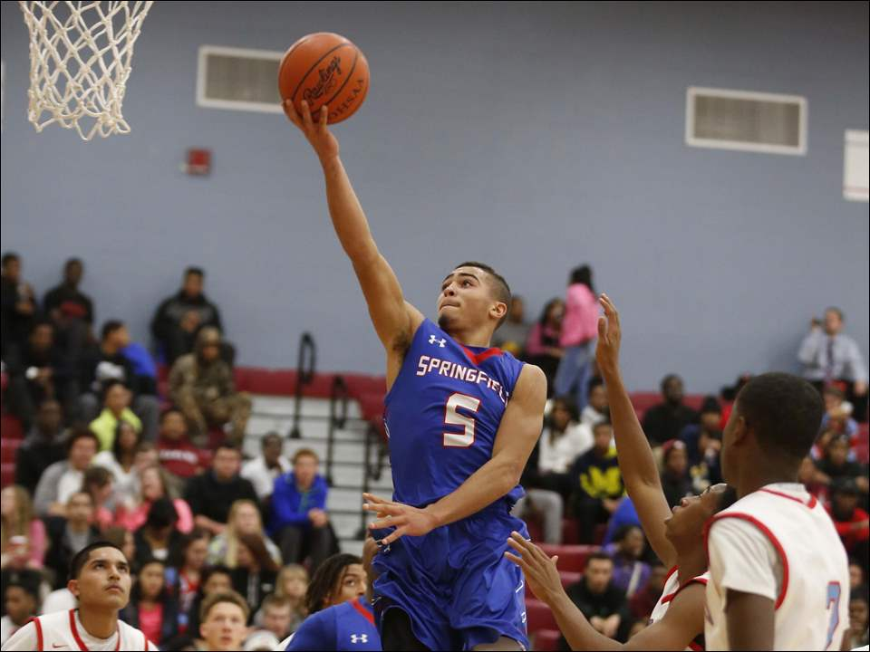 Springfield High School player Mason Durden (5) goes to the basket against Bowsher High School.