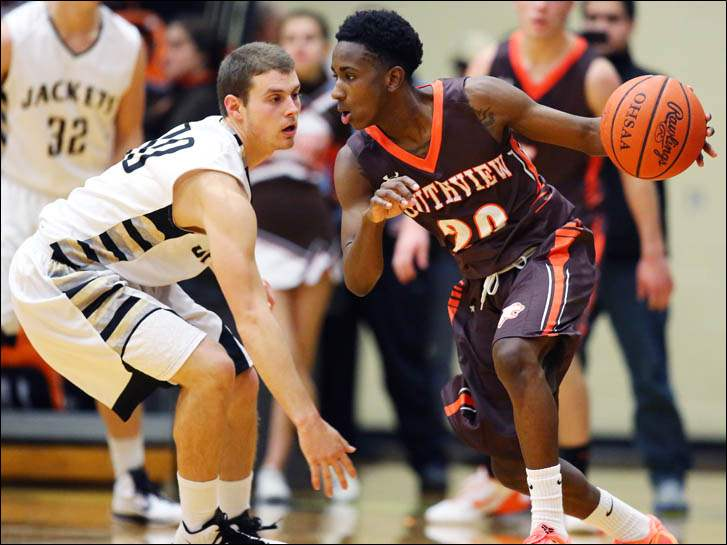 Southview's Willie Bankston (20) drives past Perrysburg's Quinn Thomas (10).