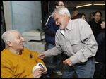 Dick Torio, left, jokes with Toledo lawyer Jon Richardson at his Torio's Health Club in March, 2013.