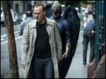 Michael Keaton portrays Riggan in a scene from 'Birdman.' The film earned a leading seven nods including best picture in the comedy or musical category.