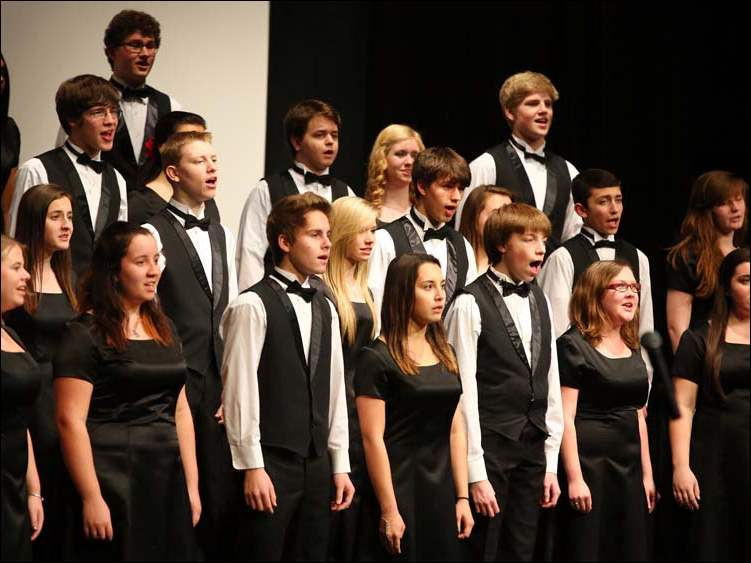 The Symphonic Chorale performs during a Holiday Concert in the Perrysburg High School Auditorium.