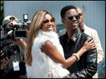 Gabrielle Union, left, and Chris Rock in a scene from