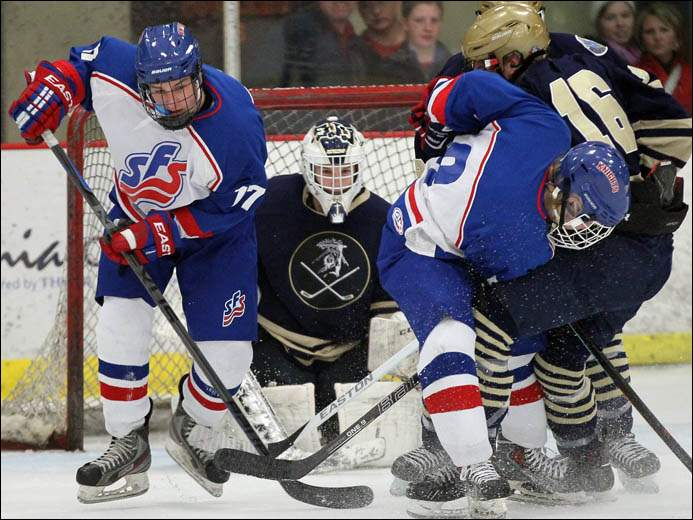 St. Francis forward Matt Barrow (17) and Matt Vild (8) try to score against  St. John's goalie Cole Kaestner (30).