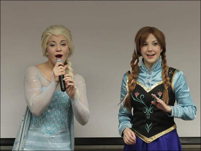 "The ""Winter Sisters"" Elsa, left, and Anna, leading the crowd in songs from the movie."