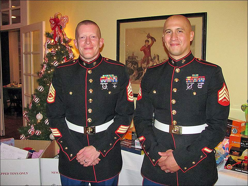 Gunnery Sergeant Joshua Fleck and Sergeant Joshua Benjamin at the Northwest Ohio Self Insurers Association holiday dinner.