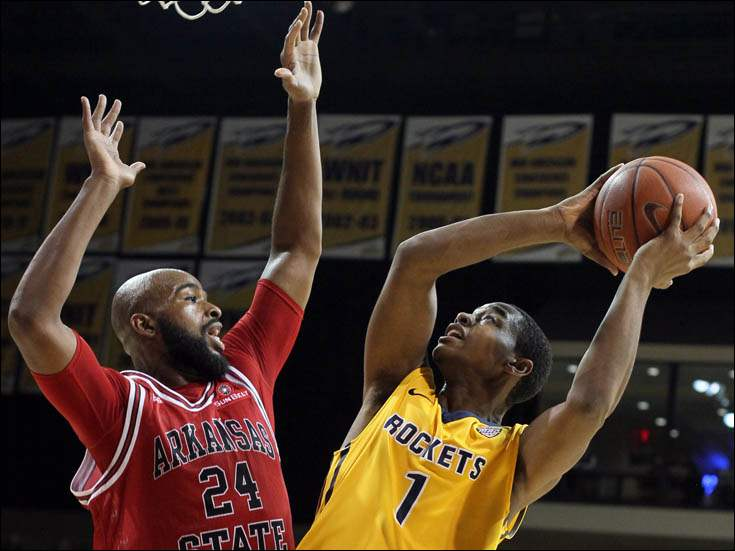University of Toledo guard Jonathan Williams (1) shoots against  Arkansas State forward Athony Livingston (24).