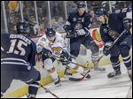 Toledo's Scott Czarnowczan is surrounded by Greenville Road Warriors during Tuesday morning's game.