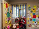 Children at Maplewood Elementary School line up for lunch in a room