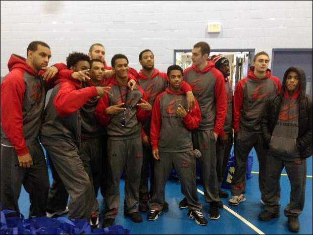 The Owens men's basketball team poses for a photo during today's volunteer event at the East Toledo Family Center.
